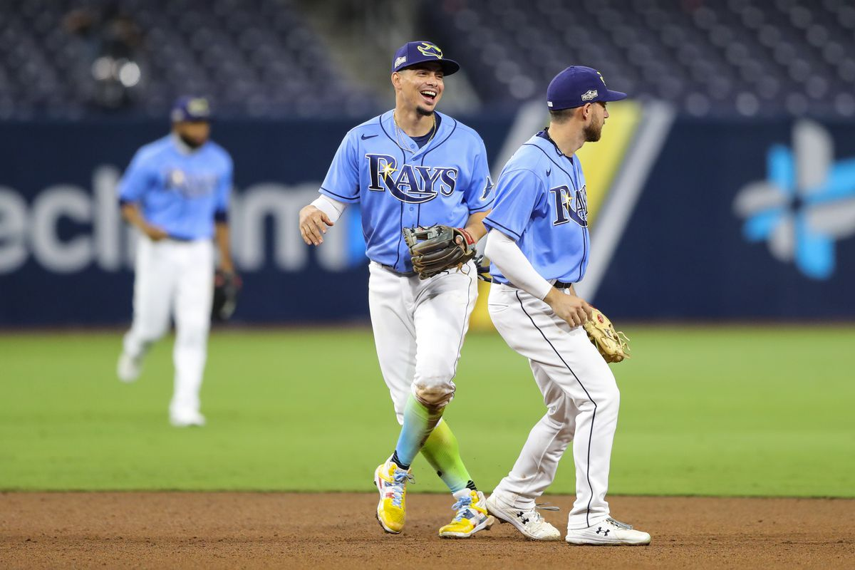 Willy Adames #1 of the Tampa Bay Rays smiles with Brandon Lowe #8 after beating the Houston Astros in Game 1 of the ALCS at Petco Park on Sunday, October 11, 2020 in San Diego, California.