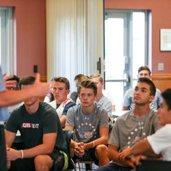 Participants listen as Max Hall speaks at the Quarterback Elite camp at Lone Peak Park in Sandy on Friday, July 1, 2016.