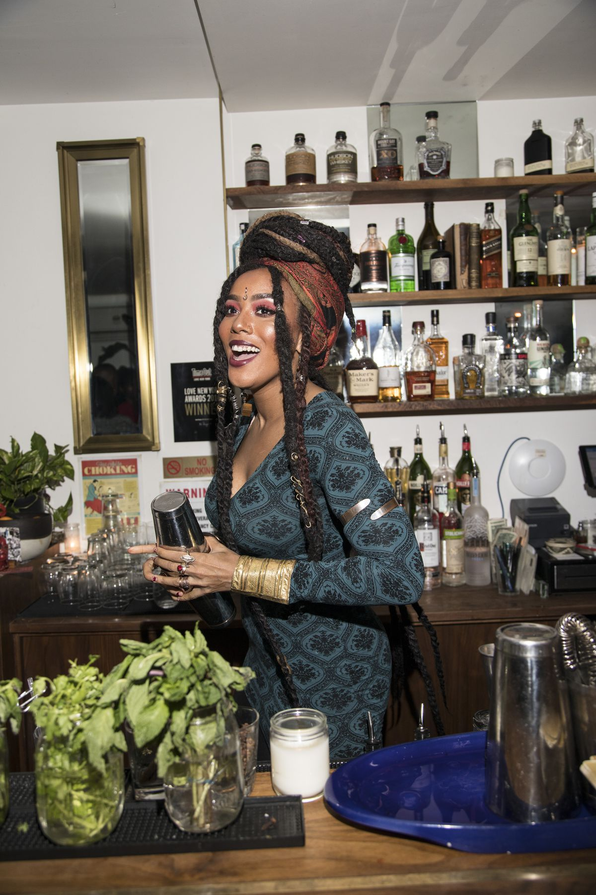 A bartender at Ode to Babel smiles at patrons