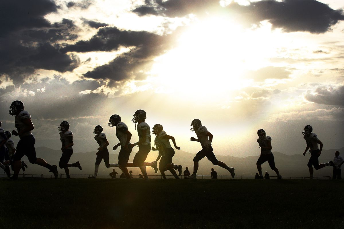 Players warm up as Bingham and Brighton prepare to face off in high school football played in Cottonwood Heights on Friday, Sept. 26, 2014.