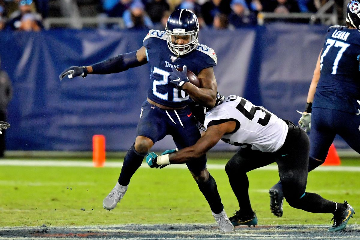 Tennessee Titans running back Derrick Henry rushes against Jacksonville Jaguars linebacker Quincy Williams during the second half at Nissan Stadium.