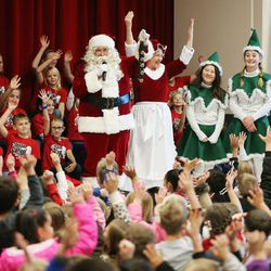 Santa and Mrs. Claus talks with Hurricane Elementary School students after Santa Flight volunteers bearing Christmas gifts landed in Hurricane on Wednesday, Dec. 7, 2016. Pilots with the Utah Wing of Angel Flight West filled 16 aircraft with 7,000 pounds toys, school supplies, books, backpacks and warm clothing for students at the Title I school. The items were gathered by 16 Boy Scouts as part of their Eagle Scout service project. Since the first Santa Flight in 2000, members of the Utah Wing have worked with their local communities to gather needed supplies and toys, and deliver them to Title I schools in rural communities throughout Utah.