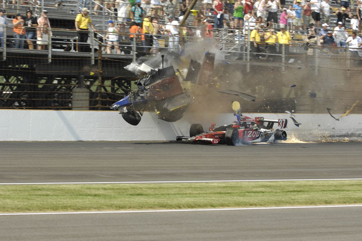 Mike Conway's Dallara disintegrates against the catchfence at the Indianapolis Motor Speedway after contact with Ryan Hunter-Reay (37) (Photo: Jef Richards/IndyCar.com)