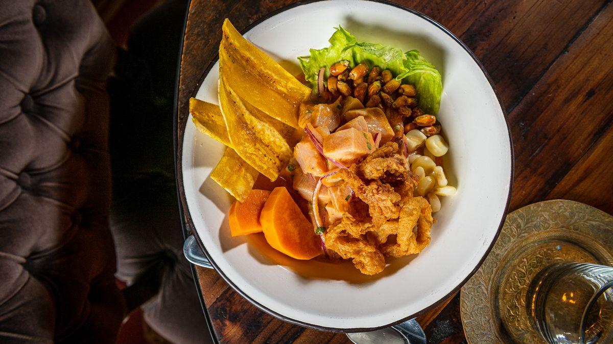 Mercado ceviche from El Secreto de Rosita presents a mix of fried calamari, rocoto chile base, mahi mahi, and fried plantain chips