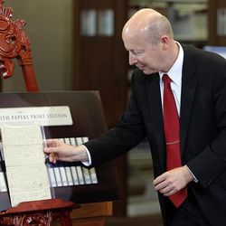Assistant Church Historian and Recorder Richard E. Turley Jr of The Church of Jesus Christ of Latter-day Saints displays historical documents during a press conference announcing the release of the latest volume in the church's ongoing Joseph Smith Papers project in Salt Lake City, Wednesday, Sept. 4, 2013.