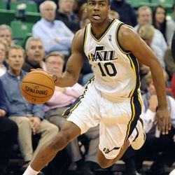 Utah Jazz point guard Alec Burks (10) drives to the basket in the second half of a game at the Energy Solutions Arena on Wednesday, October 16, 2013.