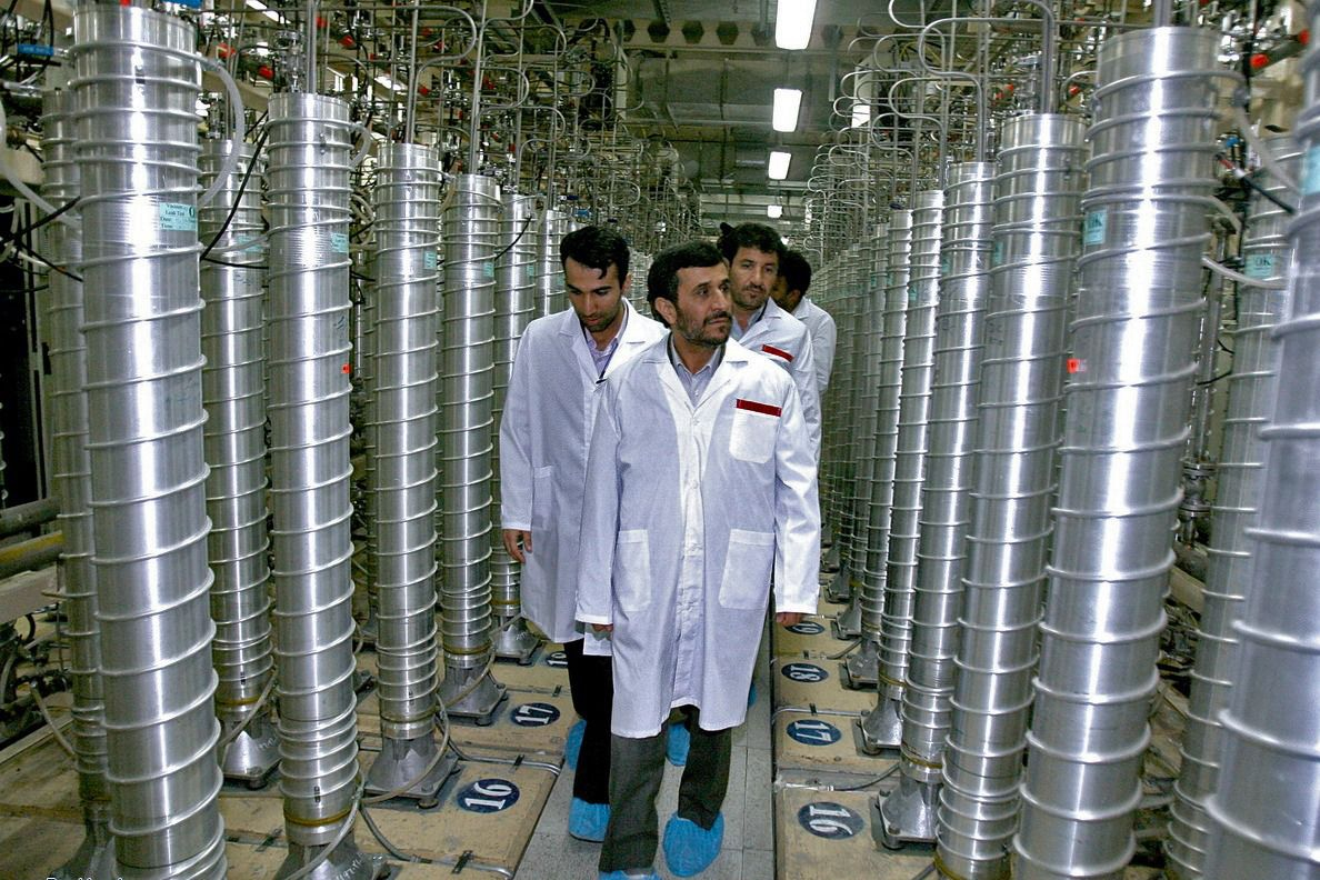Iran's then-President Mahmoud Ahmadinejad looks over centrifuges at the nuclear facility at Natanz (Photo by the Office of the Presidency of the Islamic Republic of Iran via Getty)