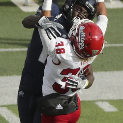 Utah State Aggies wide receiver Justin McGriff (10) can't come up with the catch under pressure form Fresno State Bulldogs defensive back Bralyn Lux (38) in Logan on Saturday, Nov. 14, 2020.