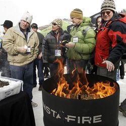 Retailers and enthusiasts look over Insta Fire as they attend the Outdoor Retailers  All Mountain Demo at Solitude Mountain Resort  Wednesday, Jan. 18, 2012. 40 outdoor recreation brands and hundreds of specialty retailers were at Solitude for a day of winter sport product previews, hands-on gear testing and outdoor events.