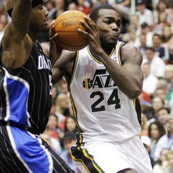 Utah Jazz forward Paul Millsap (24) drives into the paint with Orlando's #5 Quentin Richardson as the Utah Jazz and the Orlando Magic play Saturday, April 21, 2012 in Energy Solutions arena.