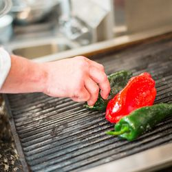 Dobkin grills peppers for the piperada.