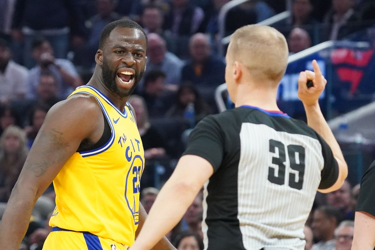 Golden State Warriors forward Draymond Green argues as NBA official Tyler Ford ejects Green against the Los Angeles Lakers during the second quarter at Chase Center.