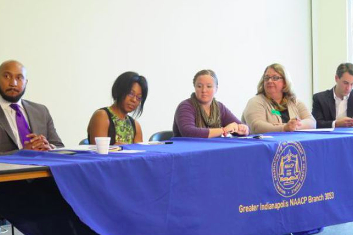 Indianapolis Public School Board candidates David Hampton, Samantha Adair-White, Annie Roof, Kelly Bentley and Josh Owens sit at a candidate forum hosted by the Greater Indianapolis NAACP chapter last month.