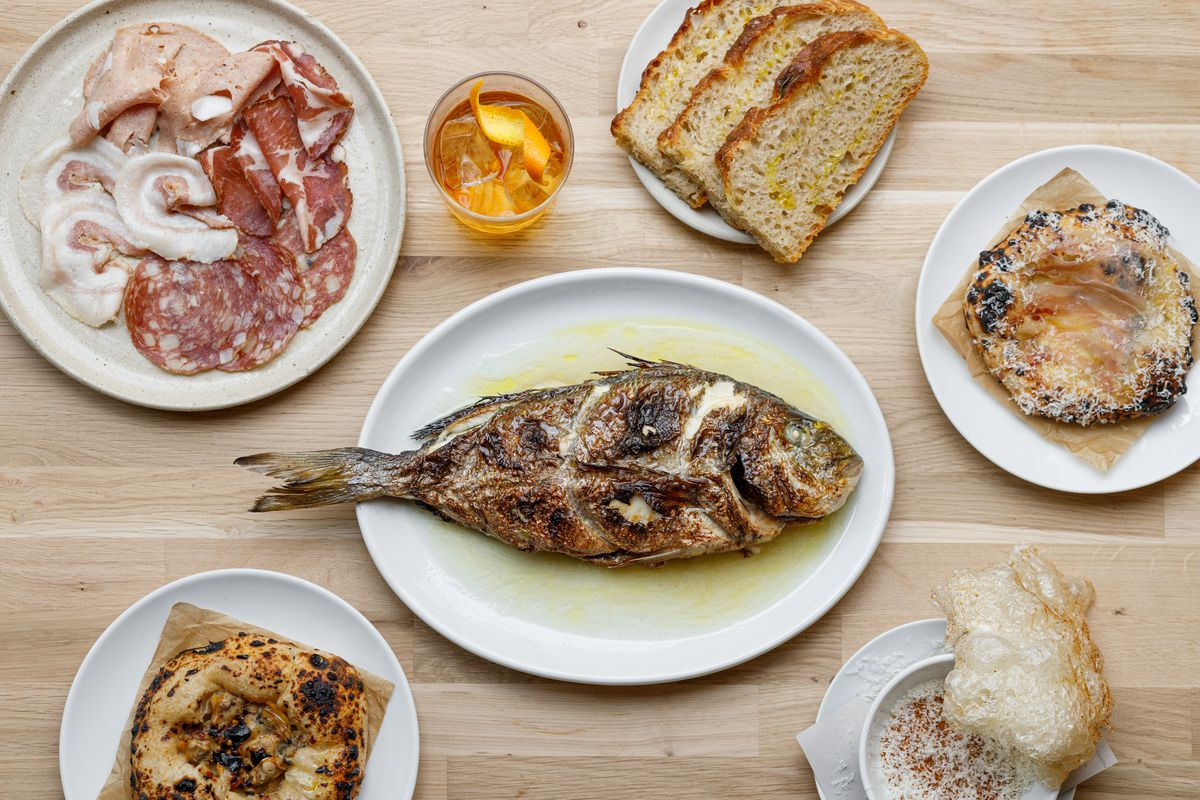 What a spread at the new Manteca might look like, featuring salumi; whole bream; and puffed pig skin