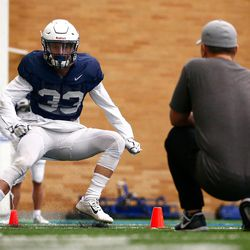 BYU wide receiver Beau Tanner runs through a drill during the Cougars' practice in the Indoor Practice Facility on Thursday, March 15, 2018, in Provo.