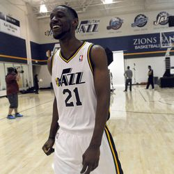 The Jazz's Ian Clark has a laugh as his teammates get their photo taken during media day at the Zions Bank Basketball Center on Sept. 30.