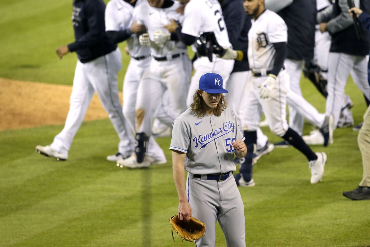 Pitcher Scott Barlow #58 of the Kansas City Royals walks off the field as the Detroit Tigers surround Robbie Grossman #8 after his walk-off single defeated the Royals 8-7 at Comerica Park on May 11, 2021, in Detroit, Michigan.