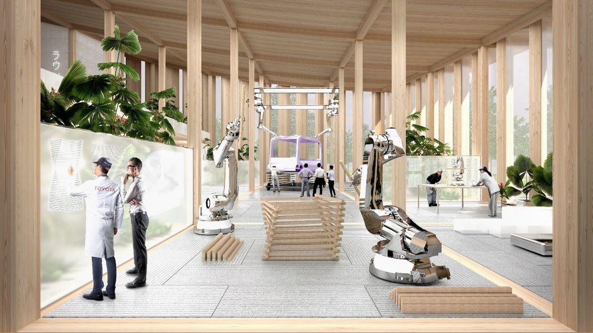 People in lab coats working alongside robots.