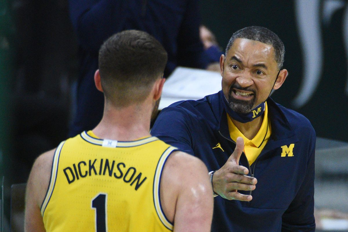 Michigan Wolverines head coach Juwan Howard and center Hunter Dickinson during the second half against the Michigan State Spartans at Jack Breslin Student Events Center.