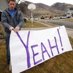 Jordan Johnson expresses his joy of Clara Lewis' recovery by hanging a sign in her yard.