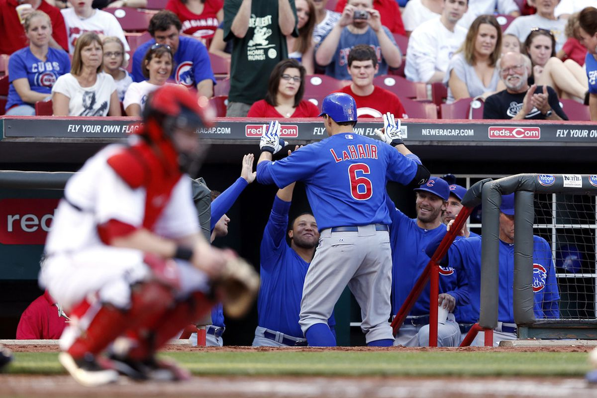 Bryan LaHair of the Chicago Cubs celebrates with teammates after hitting a home run against the Cincinnati Reds at Great American Ball Park in Cincinnati, Ohio. (Photo by Joe Robbins/Getty Images)