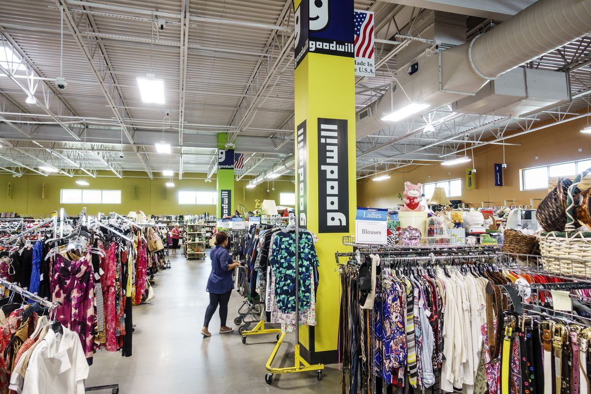 Clothing racks are on display inside a brightly lit Goodwill store in Florida.
