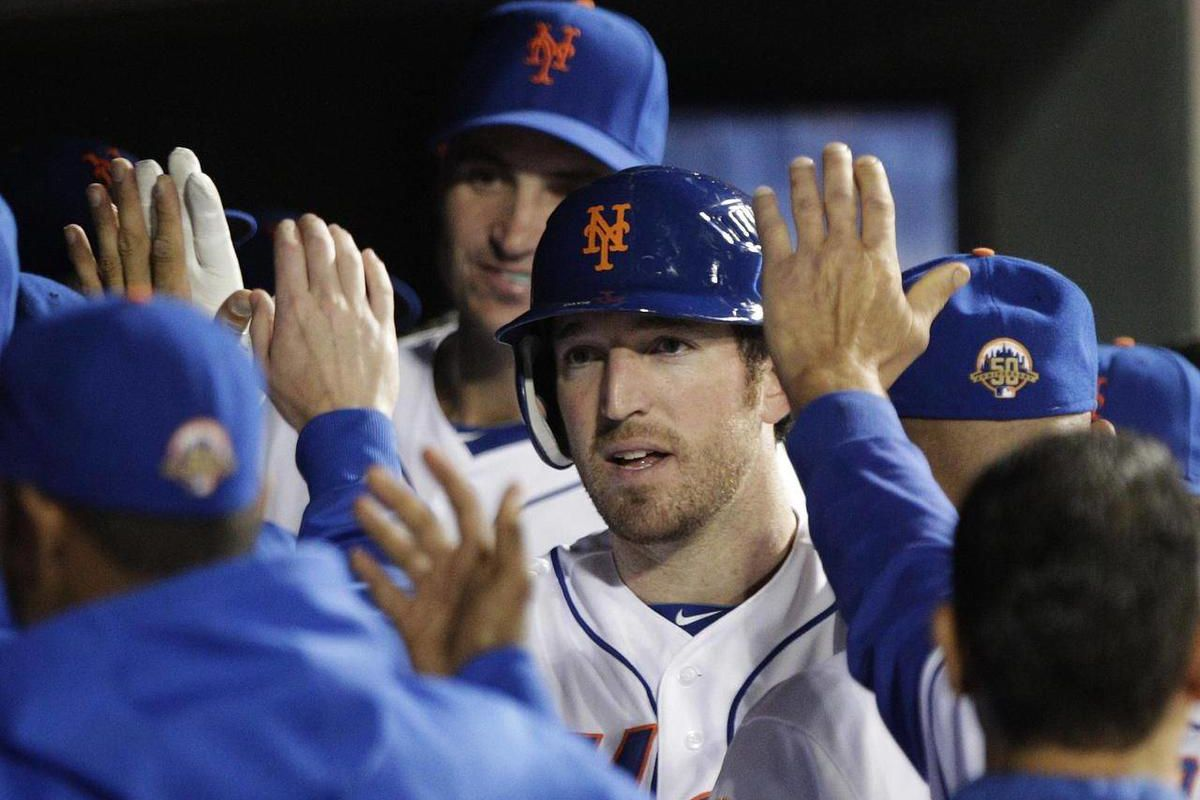 New York Mets' Ike Davis celebrates with teammates after hitting a home run during the seventh inning of a baseball game against the Miami Marlins, Friday, Sept. 21, 2012, in New York.