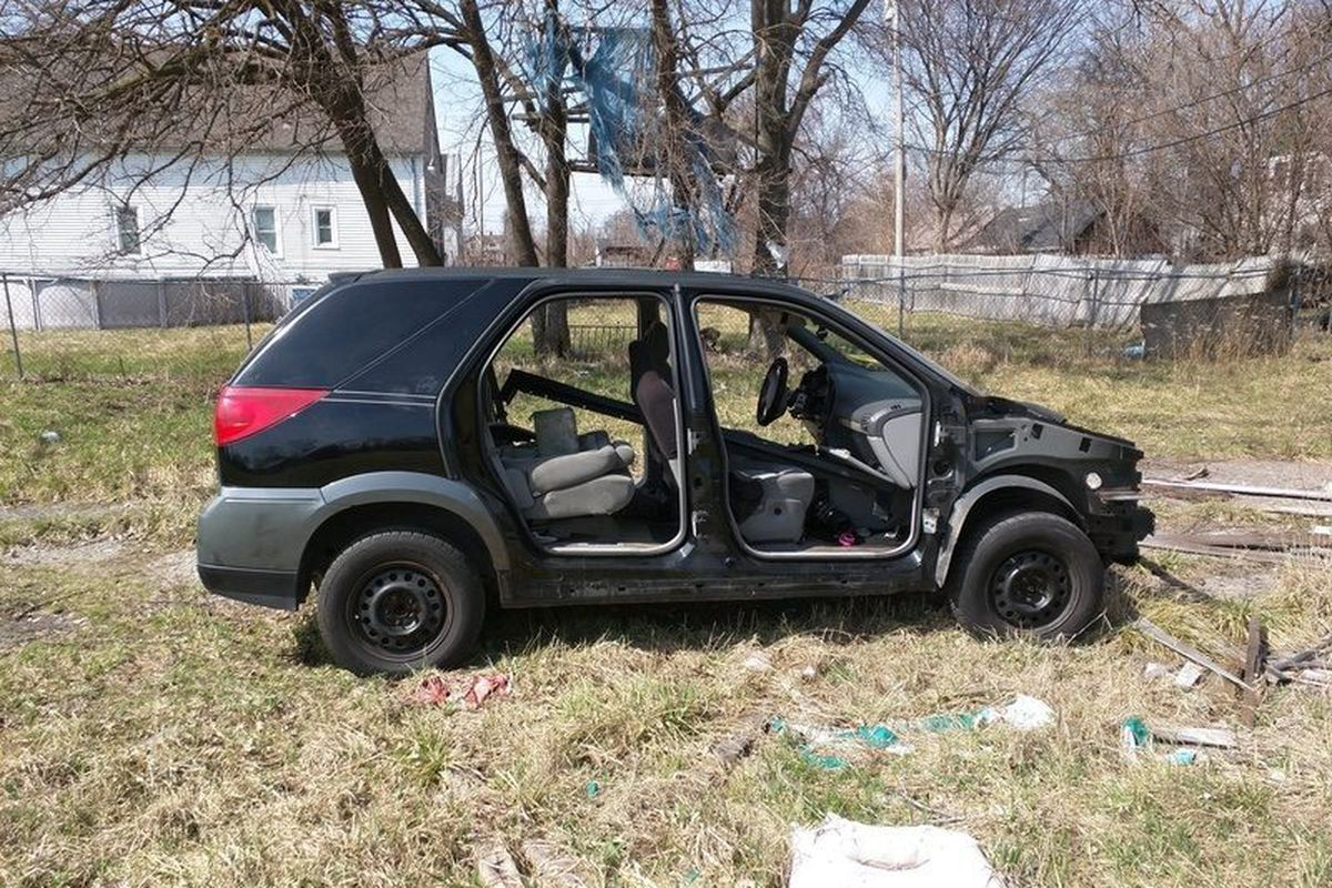 """An abandoned car reported on Farnsworth Street. Description: """"Chopped."""" [<a href=""""http://seeclickfix.com/issues/1587321?poi_token=d744682149a298142cdcbd97d8447278ff8031d9&utm_campaign=poi-notice-email&utm_content=issue-card-header&utm_medium=email&u"""