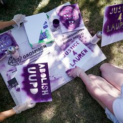 Brooke Martin, a recent graduate of the University of Utah, left, and Cassidy Hunsinger, right, a current student at the U., stencil signs of protest outside of the U. Department of Public Safety building in Salt Lake City on Thursday, Aug. 6, 2020. A small group of demonstrators gathered to protest the handling of the Lauren McCluskey case amid recent reports that a police officer showed explicit photos of the slain student to fellow officers.