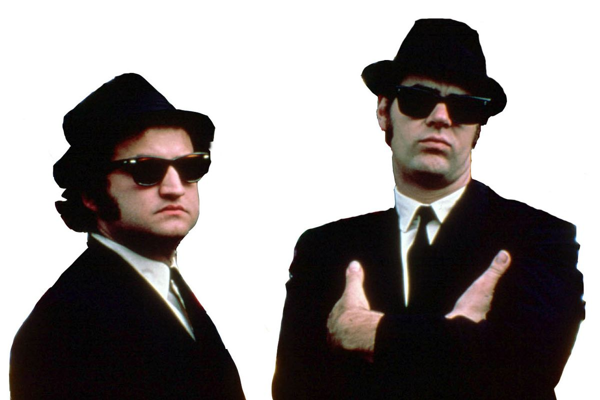 """John Belushi and Dan Akroyd are photographed on the set during the making of """"The Blues Brothers"""" in Chicago."""