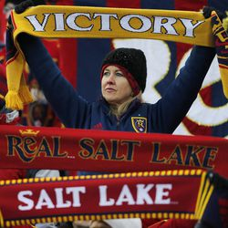A Real fan holds up her scarf as Real Salt Lake and Sporting KC play Saturday, Dec. 7, 2013 in MLS Cup action.