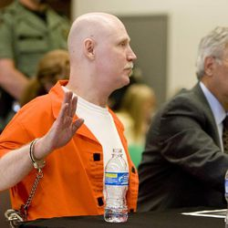 Ronnie Lee Gardner is sworn in before speaking at his commutation hearing at the Utah State Prison in Draper, Utah, Thursday, June 10, 2010. Next to him is his attorney Andrew Parnes. Gardner was executed by firing squad a week later.