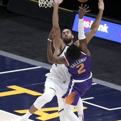 Utah Jazz center Rudy Gobert (27) guards Phoenix Suns guard Langston Galloway (2) as he shoots during a preseason NBA game at the Vivint Smart Home Arena in Salt Lake City on Monday, Dec. 14, 2020. The Jazz beat the Suns 111-92.