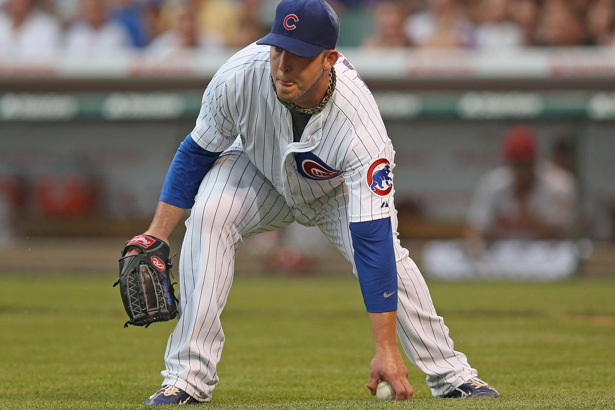 Starting pitcher Paul Maholm of the Chicago Cubs picks up a bunted ball against the Arizona Diamondbacks at Wrigley Field in Chicago, Illinois.  (Photo by Jonathan Daniel/Getty Images)