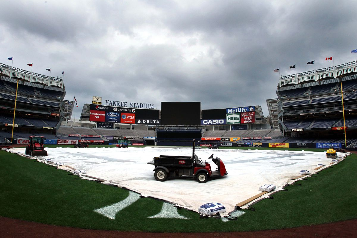 September 18, 2012; Bronx, NY, USA; A general view as heavy machinery holds down the tarp after the postponement of a game between the Toronto Blue Jays and New York Yankees at Yankee Stadium. Mandatory Credit: Brad Penner-US PRESSWIRE
