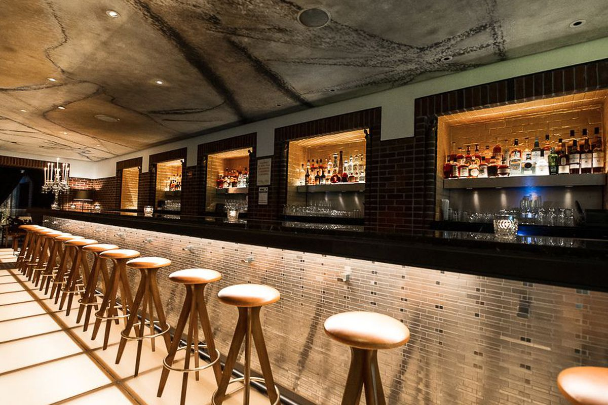 """<a href=""""http://ny.eater.com/archives/2013/09/take_a_look_around_henry_a_liquor_bar_in_the_hudson.php"""">The Henry, NYC</a>."""