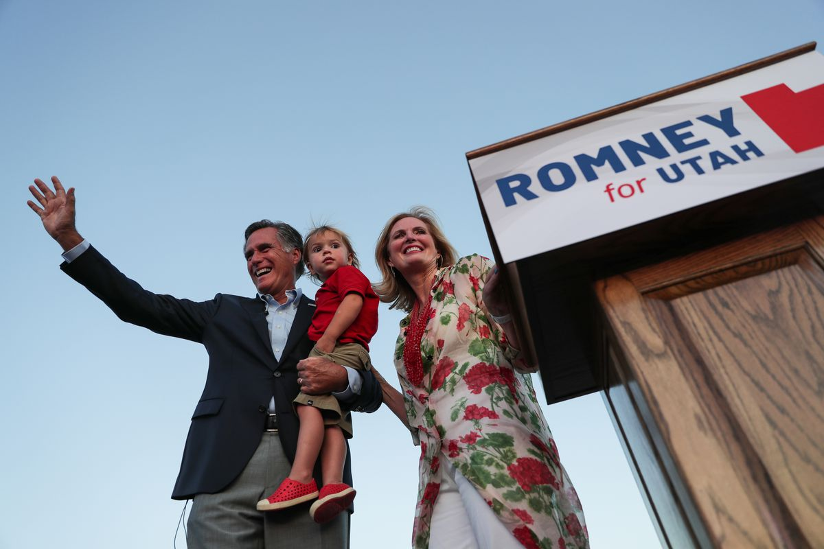 Mitt Romney, wife Ann and their youngest grandson, Dane, wave to the crowd as Mitt Romney claims victory in the Republican primary for U.S. Senate