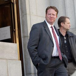 St. George businessman Jeremy Johnson leaves federal court in Salt Lake City on Friday, Feb. 1, 2013. On Monday, June 3, 2013, a federal judge in Las Vegas heard arguments for and against a government effort to delay the civil case against Johnson pending the outcome of criminal charges against him.