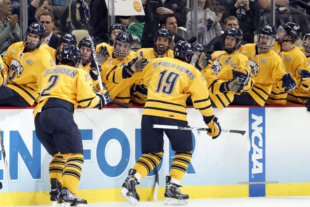 Rand Pecknold (background) and his coaching staff continue to reel in high end talent.