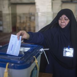 An Iranian woman votes on February 26, 2016 in Iran's first election since its landmark nuclear deal with world powers.
