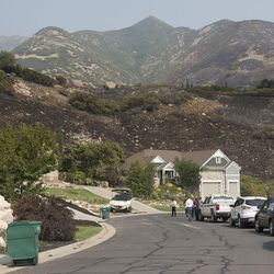 Homes surround the charred hillside of Combe Road in Ogden on Wednesday, Sept. 6, 2017. At least six structures, including multiple homes, have been destroyed after a brush fire erupted in Weber Canyon Tuesday morning.