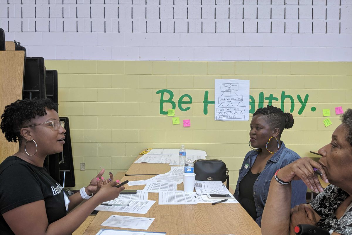 Community organizer Chanita Jones-Howard, a teacher at South Shore International College Preparatory High School, discusses solutions to enrollment and facility problems at South Side schools with school advocates.