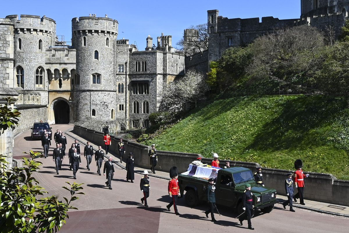 The casket of Prince Philip is driven past the Round Tower during the funeral of Britain's Prince Philip inside Windsor Castle in Windsor, England Saturday April 17, 2021.