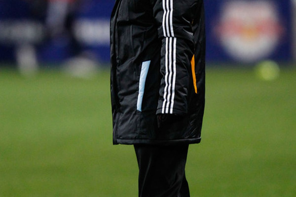 HARRISON, NJ - APRIL 02:  Head coach Dominic Kinnear of the Houston Dynamo yells to his team as they play the New York Red Bulls at Red Bull Arena on April 2, 2011 in Harrison, New Jersey.  (Photo by Jeff Zelevansky/Getty Images)