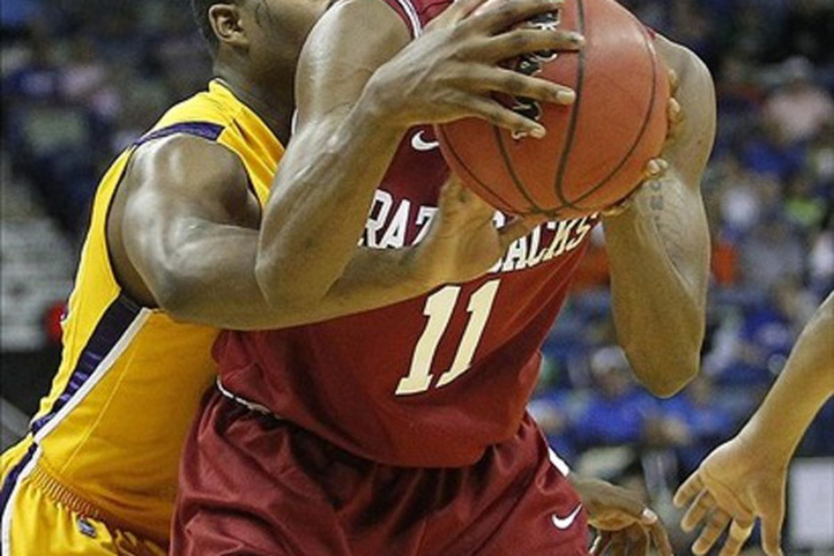 Arkansas Razorbacks guard B.J. Young is defended by LSU Tigers guard Andre Stringer during the second half of a first-round game in the 2012 SEC Tournament in New Orleans. LSU defeated Arkansas 68-54. Mandatory Credit: Crystal LoGiudice-US PRESSWIRE