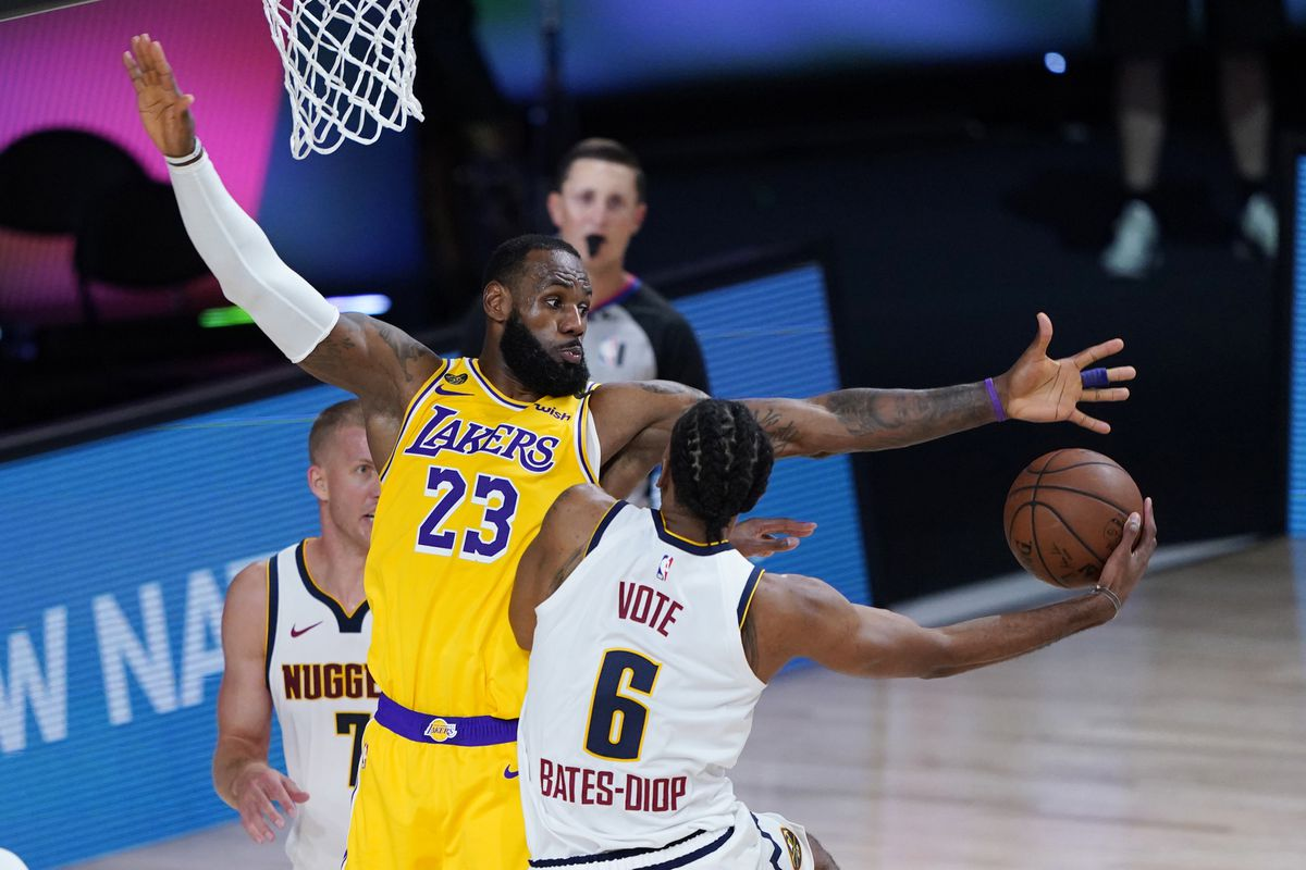 LeBron James of the Los Angeles Lakers tries to stop Keita Bates-Diop of the Denver Nuggets during the second half at The Arena at ESPN Wide World Of Sports Complex on August 10, 2020 in Lake Buena Vista, Florida.