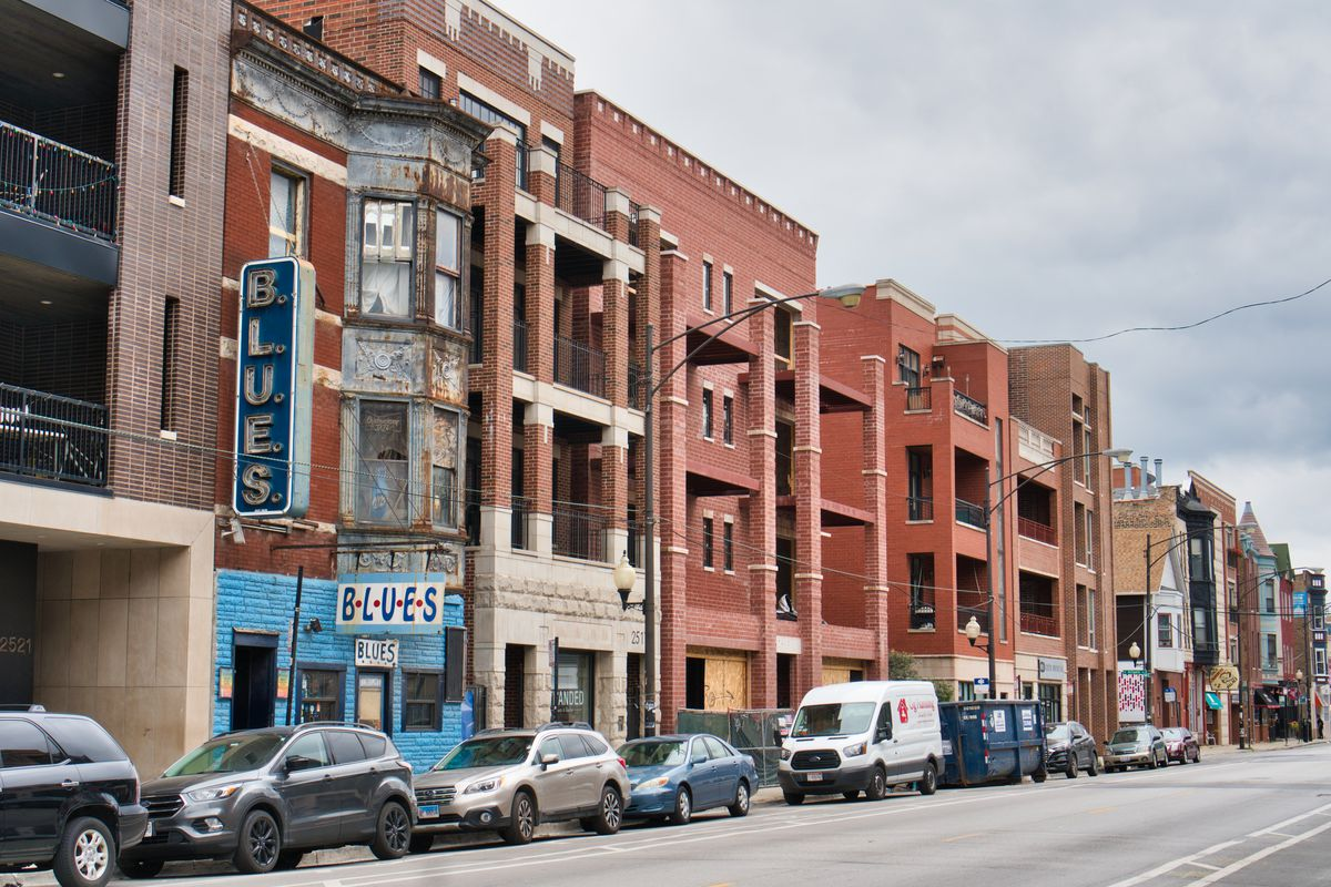 A row of brick apartments on a street in Chicago.