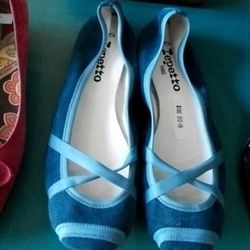 Some lady with tiny feet is going to get lucky with these pretty blue Repettos, $180