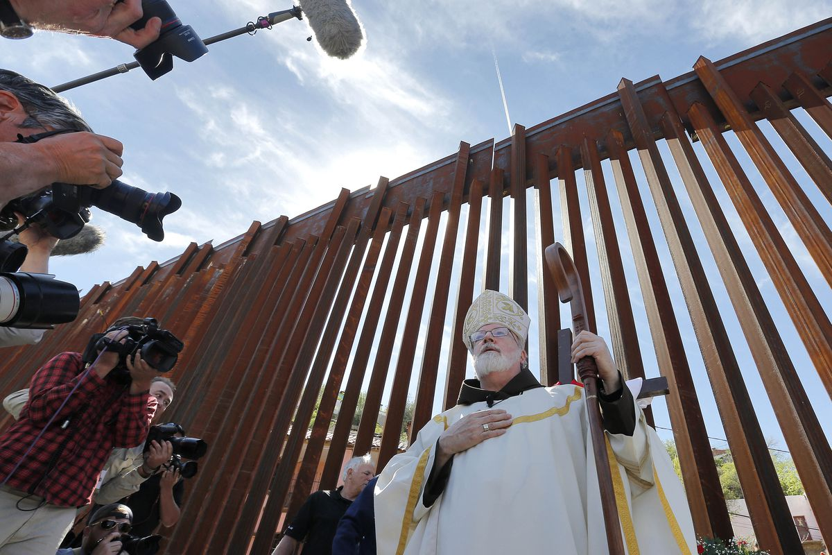 Cardinal Sean O'Malley leads mass in April 2014, along the international border wall in Nogales, Ariz.