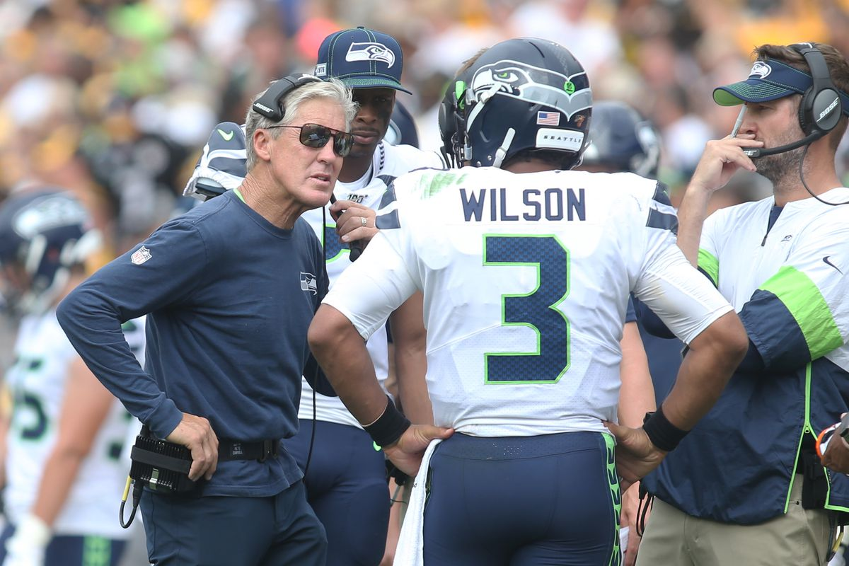 Seattle Seahawks head coach Pete Carroll talks with quarterback Russell Wilson on the sidelines during the second quarter against the Pittsburgh Steelers at Heinz Field.